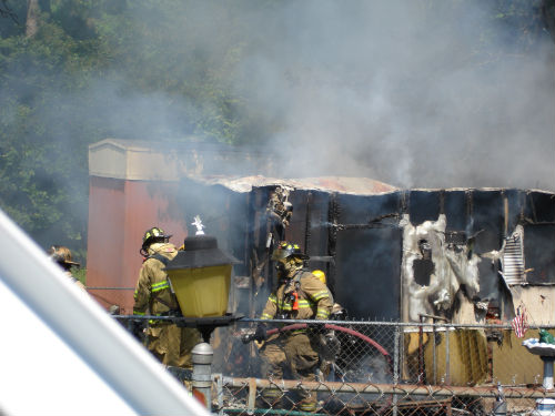 Firefighters working the Trailer Fire on Dutchess Drive on June 19, 2008.