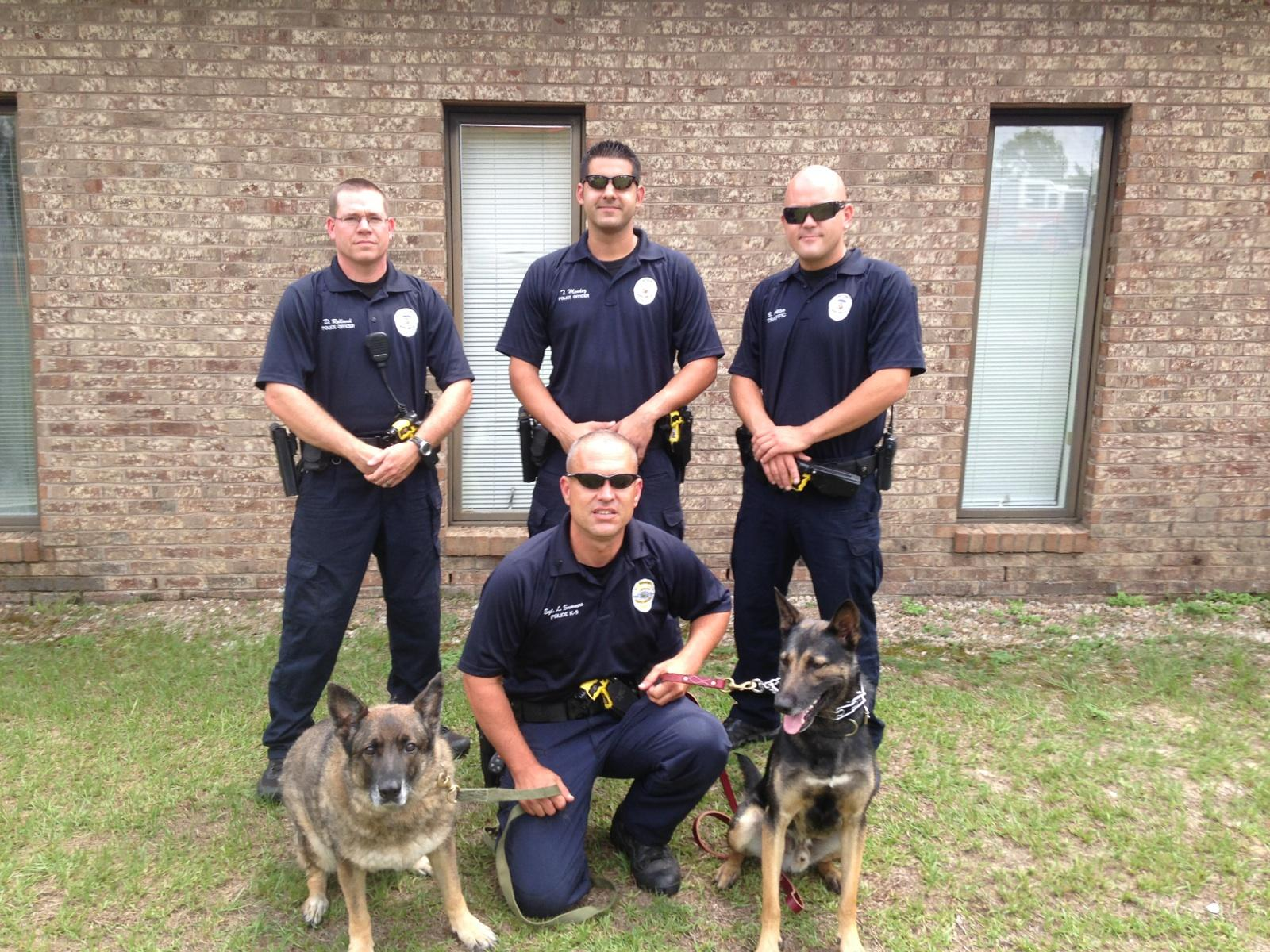 4 Police Officers with 2 K9 Officers